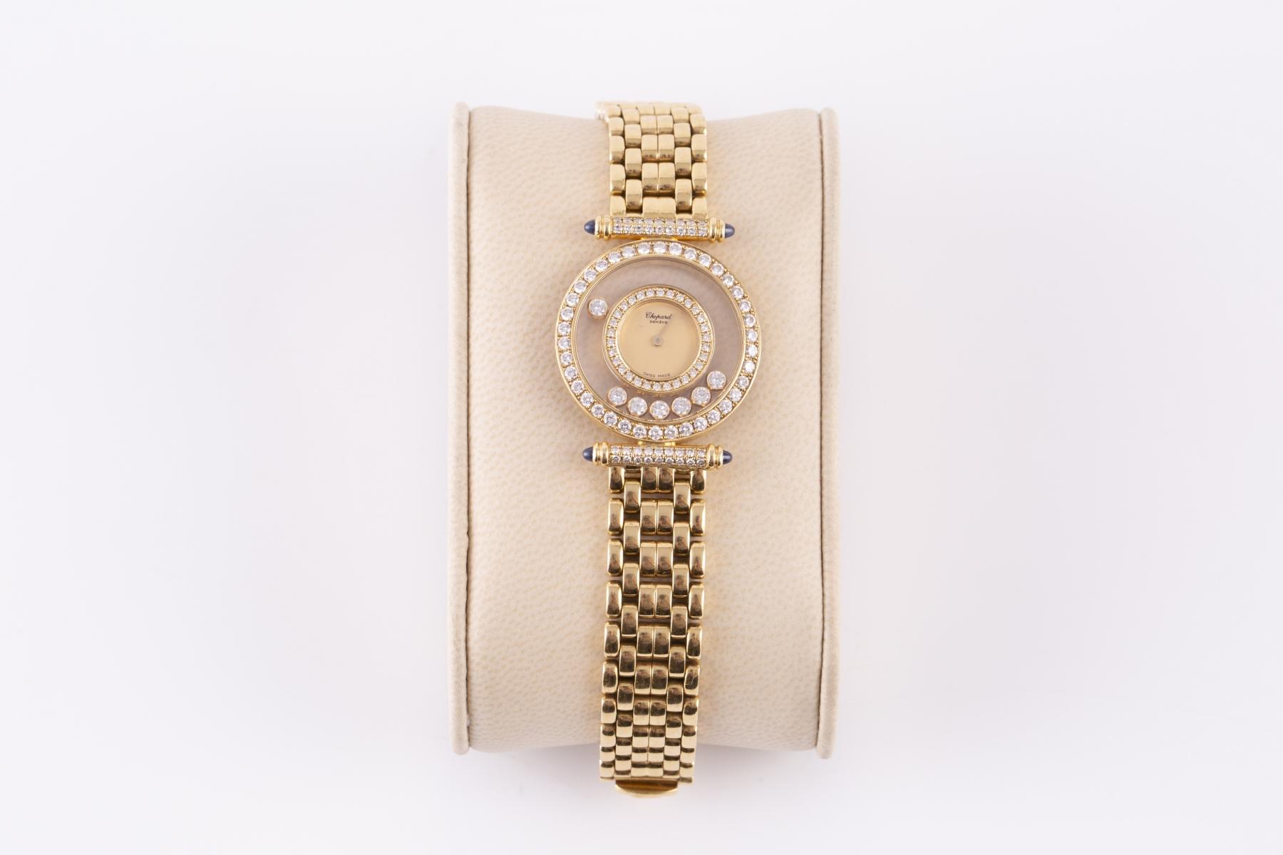 162- CHOPARD. Montre Happy Diamonds en or jaune le cadran entouré de diamants, numérotée. Adjugé 4800€