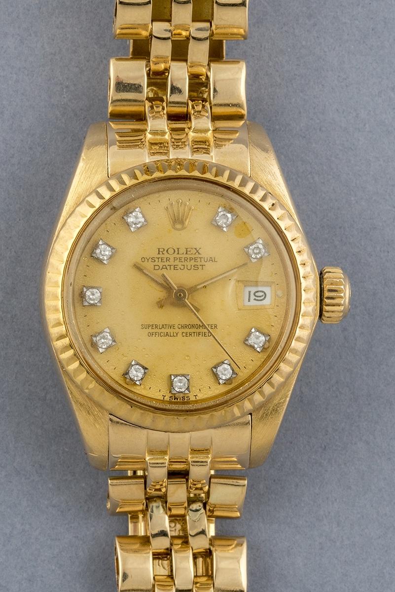 100- ROLEX. Montre de dame en or jaune 18K Modèle Oyster perpetual datejust. Poids brut 55,1g. Adjugé 3100€