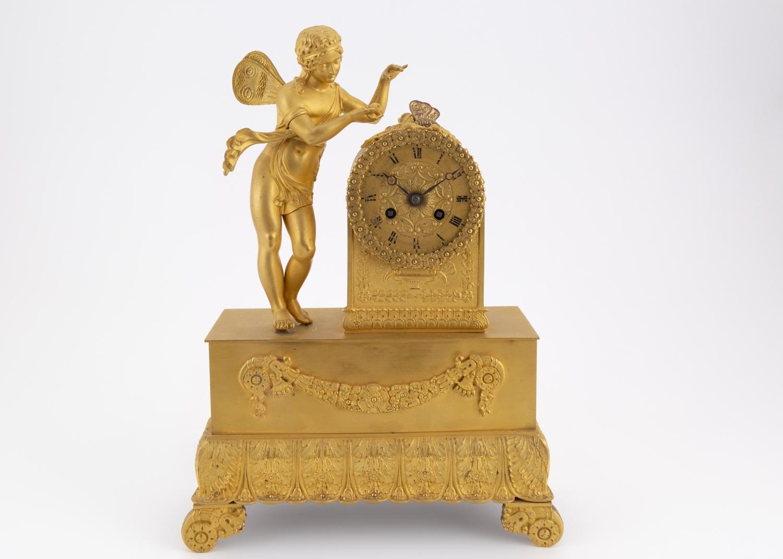 174- Pendule à l'amour en bronze doré et ciselé époque XIX°. Adjugé 250€