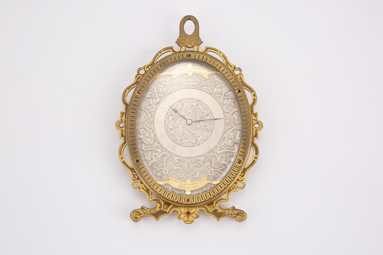 78- Charles OUDIN. Pendulette de table en bronze doré ciselé. Adjugé 550€