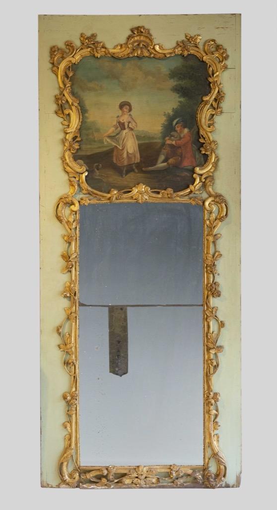 167- Trumeau en bois laqué et bois doré sculpté. La partie supérieure ornée d'une huile sur panneau. Epoque XIXème. 238x102cm. Adjugé 1200€